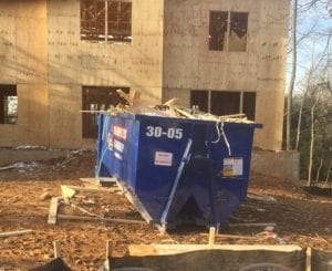 How having a dumpster on a construction site benefits a contractor.